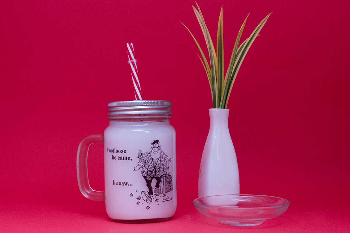 glass jar with straw